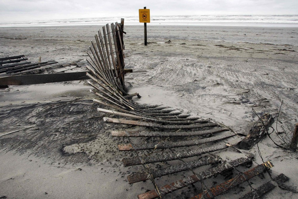 A dune fence lies twisted in the sand of the beach in the aftermath of Hurricane Sandy in Atlantic City, New Jersey.