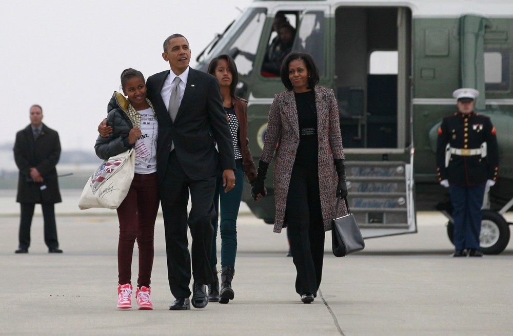 US President Barack Obama, first lady First lady Michelle Obama and her daughters walk to Air Force One in Chicago. The first family are returning to Washington following Barack Obama(***)s second term win.