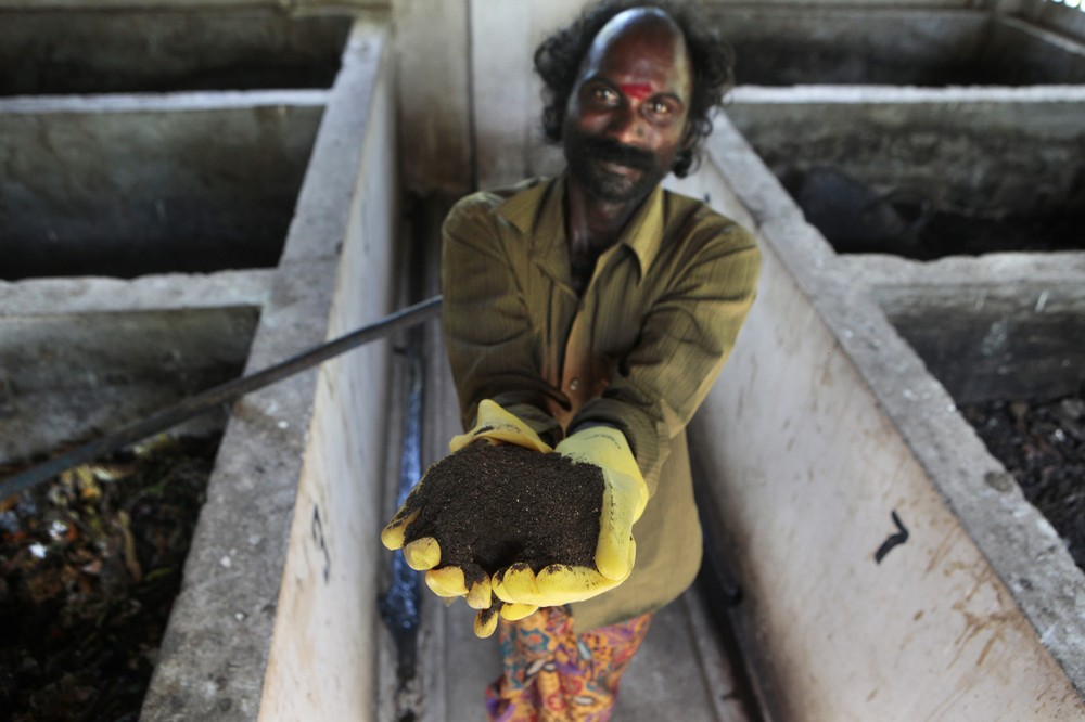 Waste collector, Varghese, holds a handful of compost at the compost site, at Chinnavilai village, India.It is estimated that around 2.5bn people around the world lack access to safe sanitation.