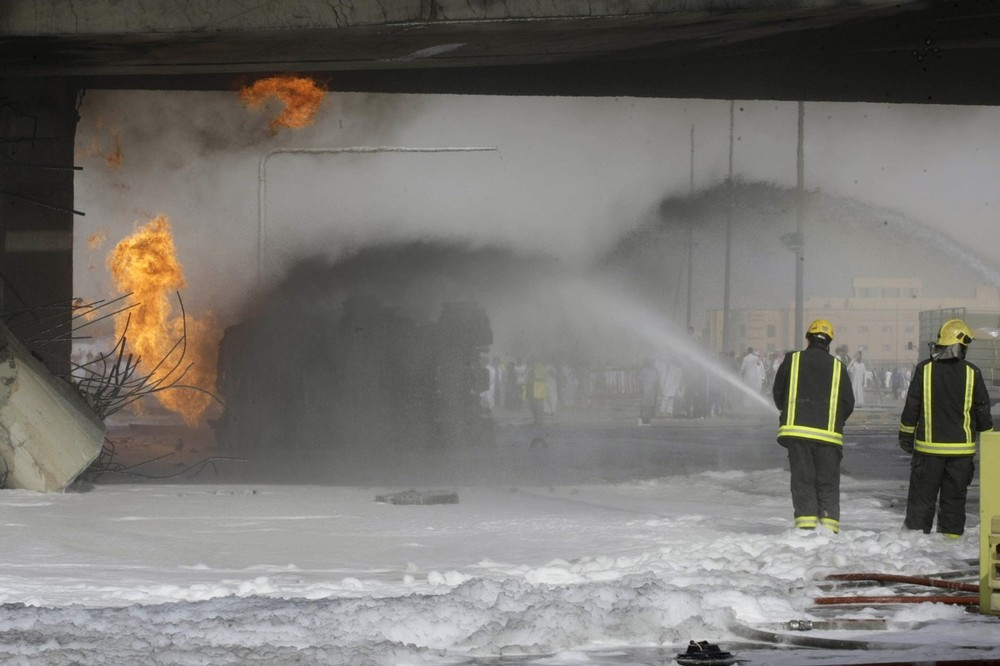 Saudi civil defence members extinguish a fire after an explosion which severely damaged an industrial building in eastern Riyadh on November 1. At least 22 people were killed when a fuel truck crashed into a flyover in the Saudi capital on Thursday, triggering the explosion that brought down the industrial building, Saudi state television reported.