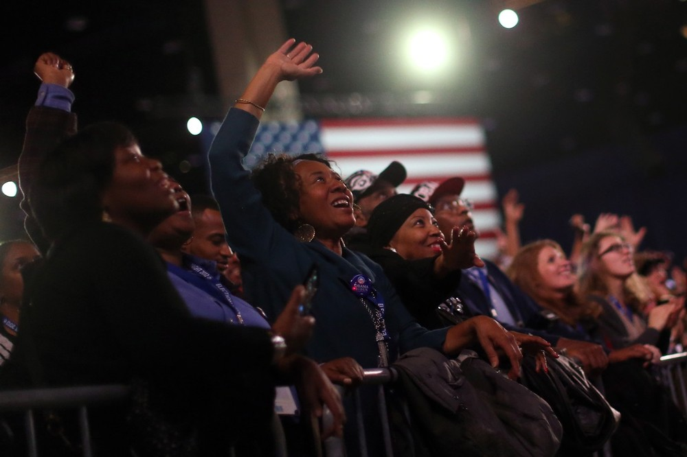 Obama supporters cheered during an election night watch party in Chicago, Illinois, as results favouring the incumbent trickled in.