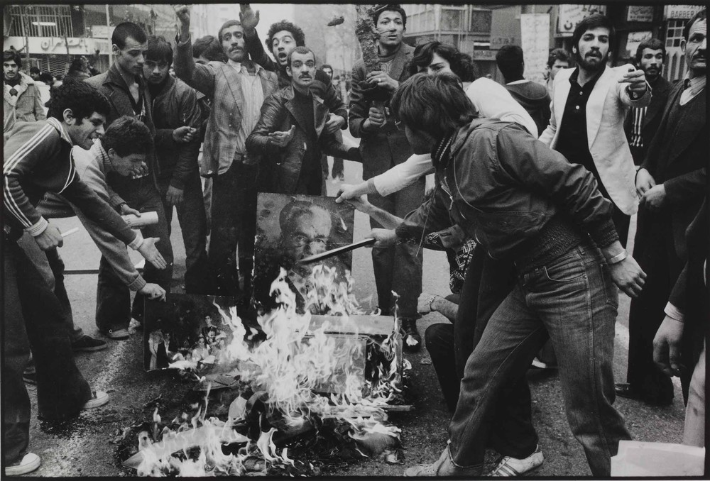 """Rioters burn a portrait of the Shah"" during the 1979 Iranian revolution, by the iconic Iranian photographer Abbas. The series of news photographs serves as a prelude to the exhibition, as curator Marta Weiss explained, ""to indicate that photography in the Middle East is not brand new, that it hasn(***)t suddenly emerged from nowhere""."