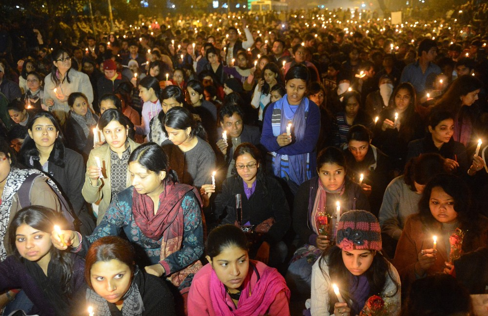 Indian protesters hold candles during a rally in New Delhi on December 29 after the death of a student who was gang-raped in the Indian capital. Indian leaders appealed for calm fearing fresh outbursts of protests after her death. New Delhi\(***)s top police officer and chief minister have urged people to mourn her death in a peaceful manner as large parts of the city centre were sealed off.