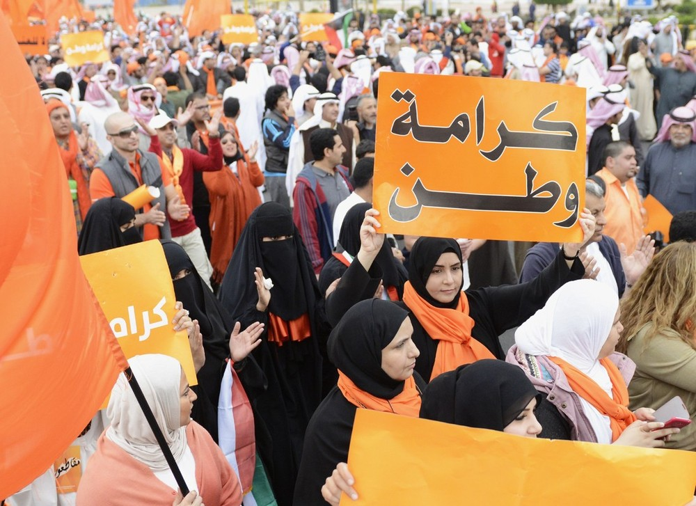 Tens of thousands of Kuwaiti protesters marched to Kuwait Towers in a peaceful demonstration against a parliament elected last week in the Gulf Arab state under voting rules deemed unfair by the opposition.