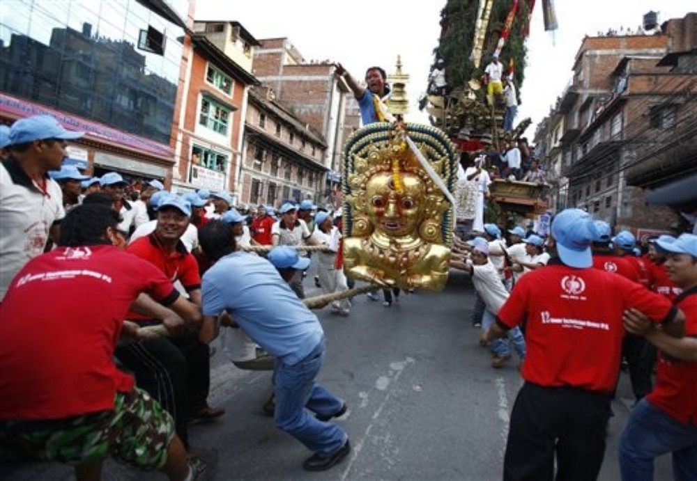 The chariot of Rato Machhindranath, known as the God of Rain, is pulled 