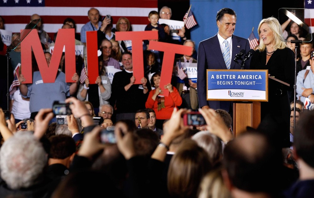 Republican presidential candidate Mitt Romney and his wife address the crowd at a campaign rally. Romney <a style=&quot;color:#FB9d04&quot; href=&quot;http://www.aljazeera.com/news/americas/2012/04/20124251443738583.html&quot;><strong>earned a commanding lead</strong></a> over rival Newt Gingrich after winning five more primary polls, leading Gingrich to say he would pull out of the race.