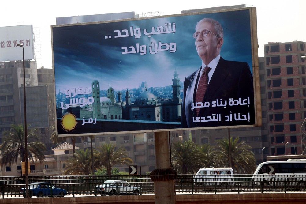 A billboard with former Arab League General-Secretary and candidate Amr Moussa looms over a highway in Cairo. The first round of Egypt's upcoming elections will take place on May 23 and 24, with a runoff scheduled for June 16 and 17 if no candidate clears 50 per cent of the vote.