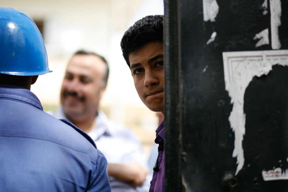 A young man waits to vote in the Smouha area of Alexandria.