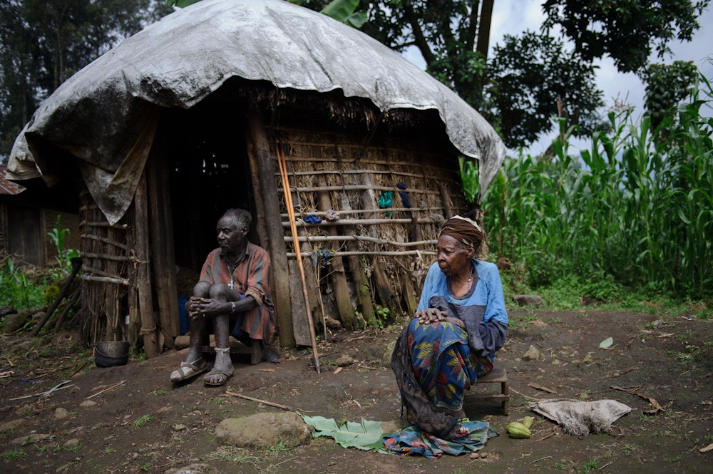 Veronica Nyiramitana and her husband, Josephu Jibesho, sit outside their small home in the village of Gisiza, two of only three people known to have stayed after fighting broke out. Their home is overlooked by a rebel position on a nearby hill from which gunfire regularly echoes.