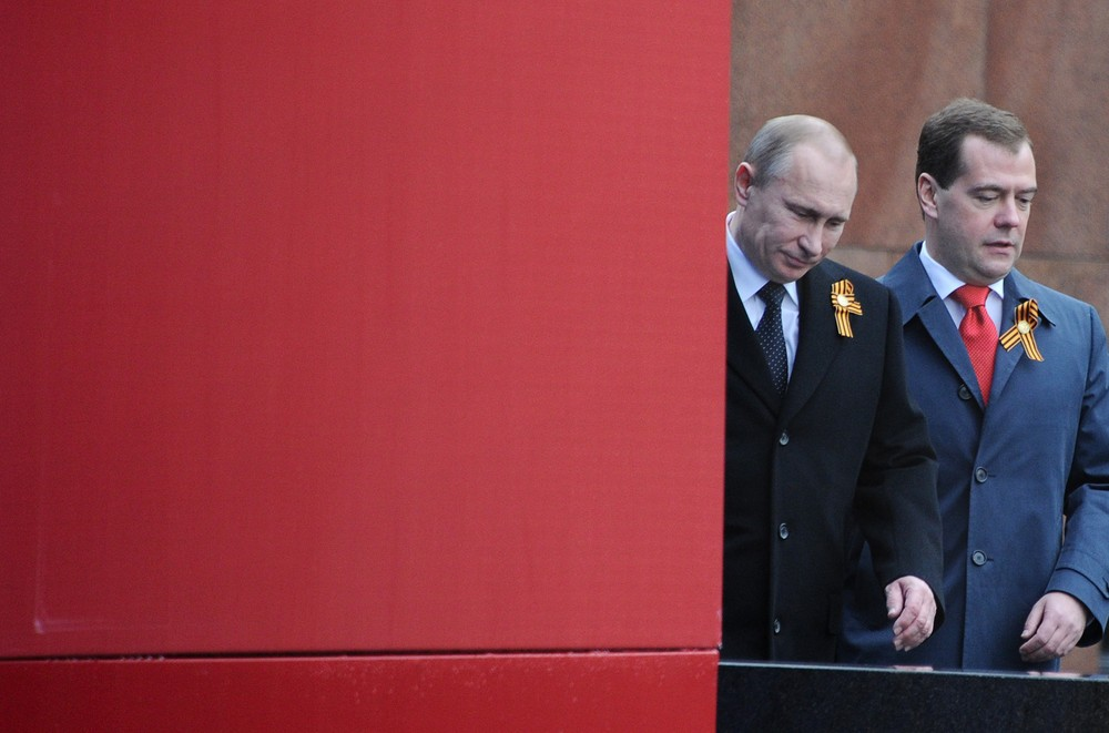 Newly-inaugurated President Vladimir Putin (L) and new Prime Minister Dmitry Medvedev arrive to watch Victory Day parade at the Red Square in Moscow