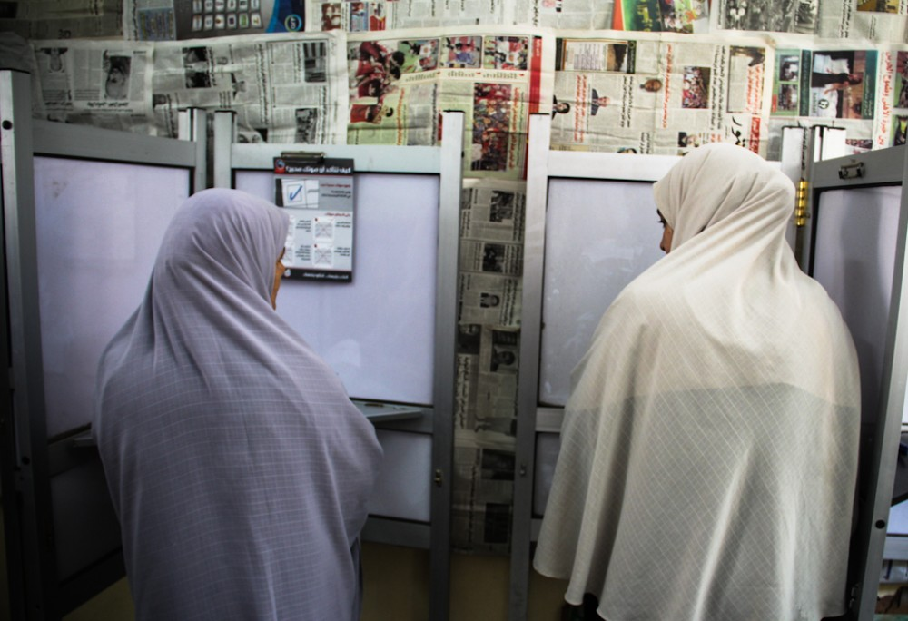 Women casting their votes inside the polling station.