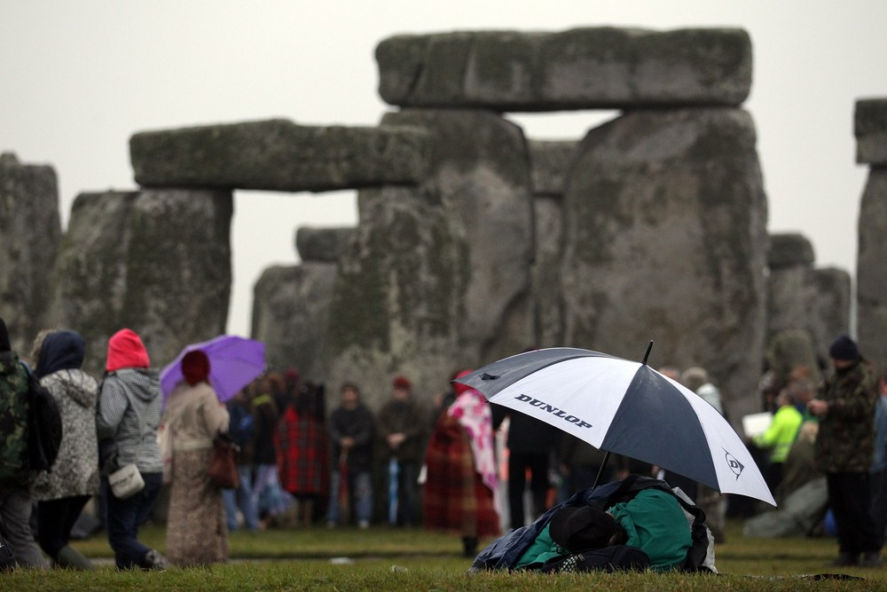 21 June 2012: Around 5,000 people gathered to watch the summer solstice at Stonehenge in Wiltshire, UK. Overcast skies and heavy rain prevented any sighting of the sun.