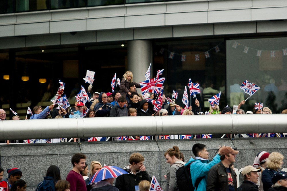 Crowds of people gathered in front of London(***)s City Hall to see the queen as she cruised along on the Thames River for the Diamond Jubilee, marking her 60th year on the throne. She is only the second monarch in UK history to have achieved the milestone.