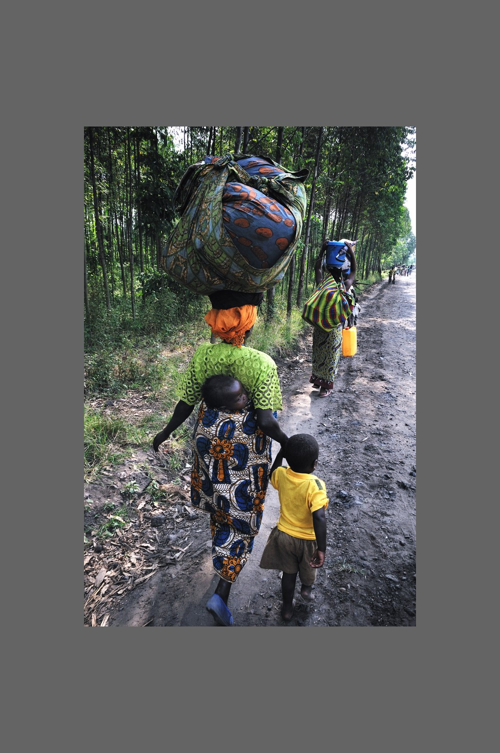A mother and her two children leave the Bunagana district ahead of an expected round of fighting between rebel M23 soldiers and troops from the Democratic Republic of the Congo army. The UN estimates that more than 200,000 people have been forced to flee their homes.