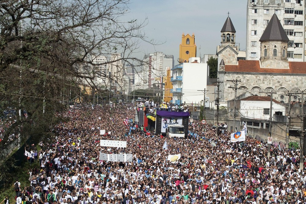 A crowd of faithful participate in the (***)Marcha de Jesus(***) (Rally of Jesus) through the main streets of Sao Paulo, Brazil.