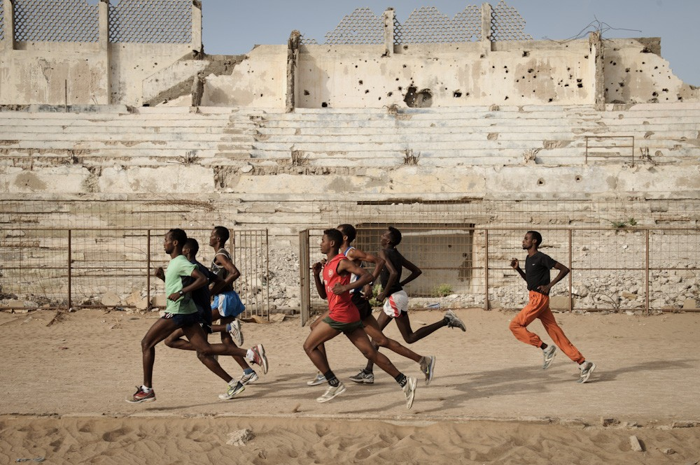 In Mogadishu\(***)s bullet-ridden Konis stadium, a small group of motivated runners have finally found a place in which to train for the Olympics.
