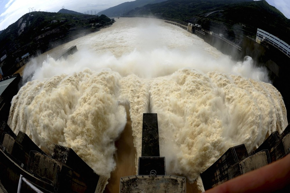 Water pours out from the dam of the Shuikou Reservoir on Minjiang river as part of flood control measures ahead of the rainy season in Minqing county in  Fujian province.