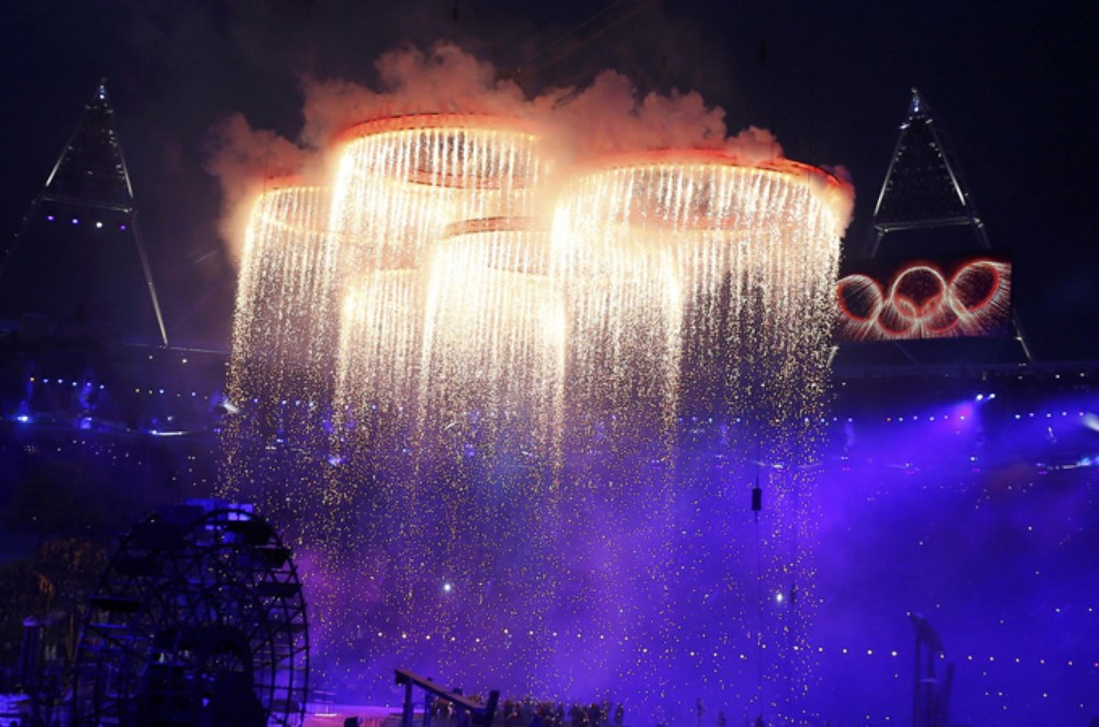The Olympic rings converge together above performers during the opening ceremony of the London 2012 Olympic Games.