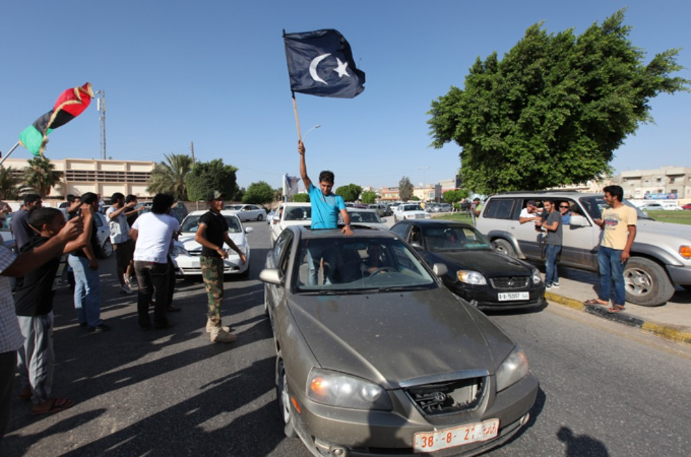 The black Cyrenaica flag is used by federalist protesters aiming to create an eastern region independent from Tripoli.