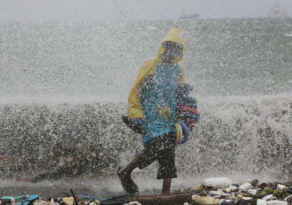 Strong winds and heavy rain, triggered by Tropical Storm Saola, have caused havoc across the Philippines.