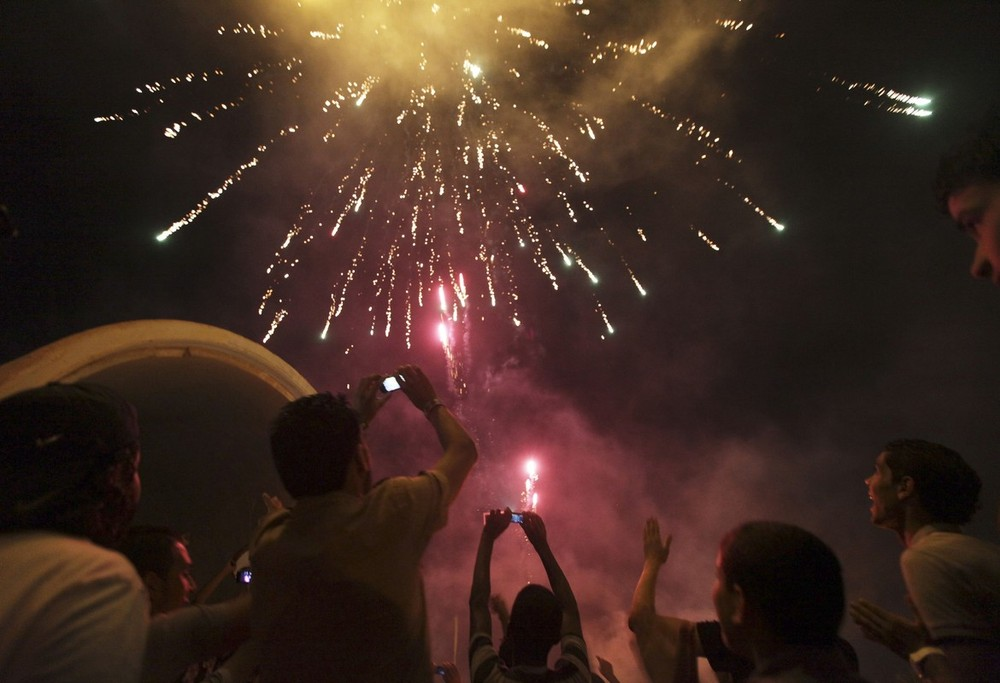 Fireworks explode in the sky as people celebrate after polling stations closed during national election in Benghazi. Libya began its first free national election in 60 years on Saturday.