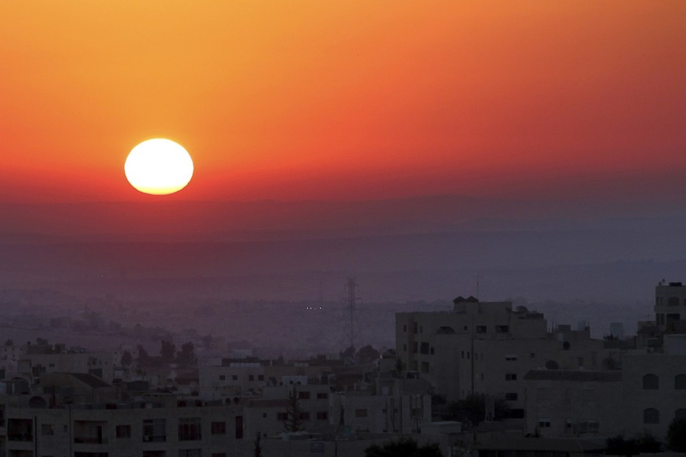 The sun rises on Eid al-Fitr, a religious holiday for Muslims, in Amman, Jordan. Eid-al-Fitr marks the end of Ramadan, the holiest month on the Islamic calendar, during which Muslims refrain from food, water, or sexual relations from dawn until sunset.