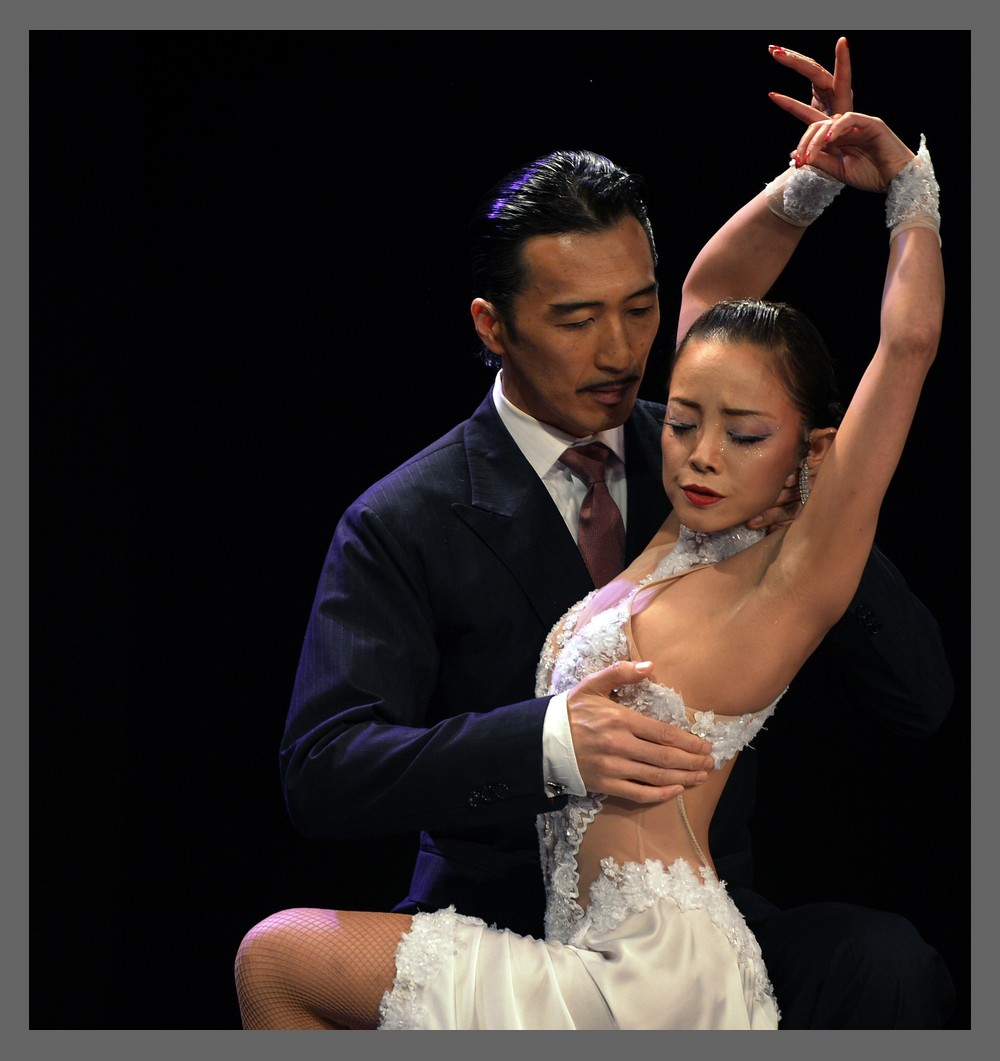 More than 350 couples participated in the festival\(***)s Salon Tango competition, and over 100 couples in the Stage Tango competition. Stage Tango is highly choreographed, whereas Salon Tango involves more improvisation. Above, Japanese couple Manabu Kato and Genta Nakazawa compete in the Stage Tango semifinal round.