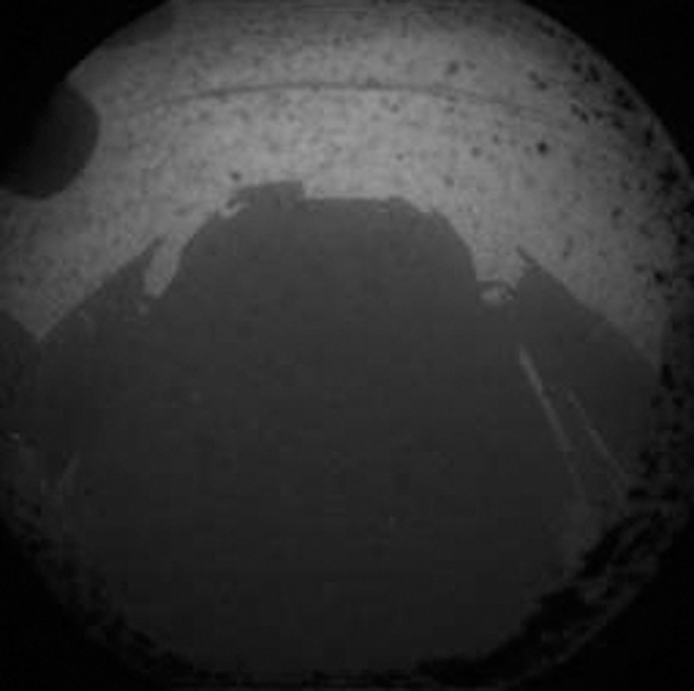 One of the first views from NASA\(***)s Curiosity rover, which landed on Mars the evening of August 5.