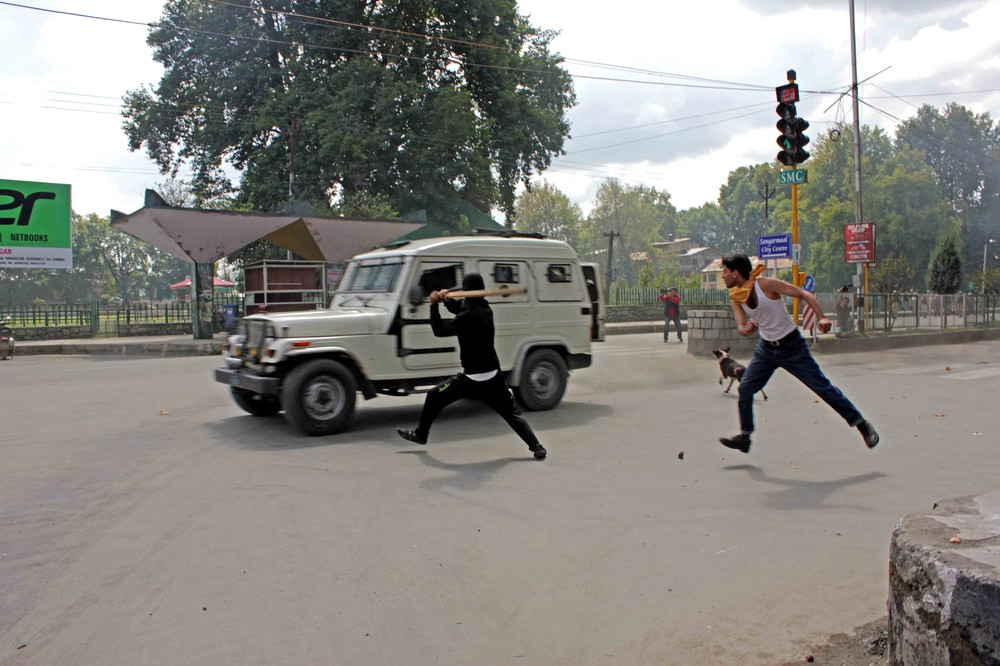 "Angry protesters threw stones at a police vehicle in Srinagar, the capital of Jammu and Kashmir, during a protest over the anti-Islamic film ""The Innocence of Muslims"" on September 18, 2012."