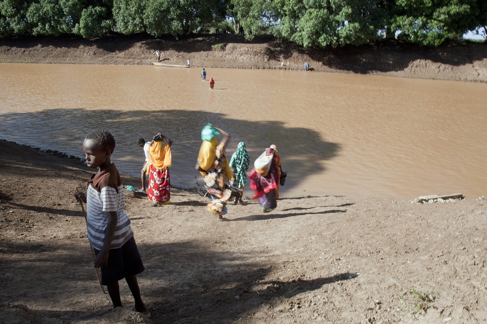 Orma pastoralists displaced by recent violence cross the Tana River.