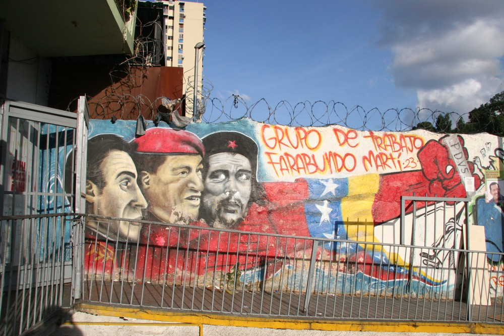 Supporters believe deceased president Hugo Chavez followed in the footsteps of other Latin American revolutionaries. This image in downtown Caracas shows Chavez beside Venezuelan independence hero Simon Bolivar and communist revolutionary Ernesto Che Guevara.