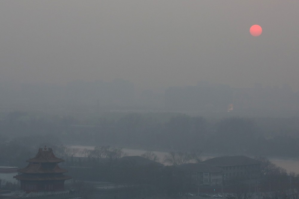 Heavy smog shrouded Beijing with pollution at hazardous levels beginning on January 12. Above, a general view of the pollution-covered watchtower of the Forbidden City in Beijing.