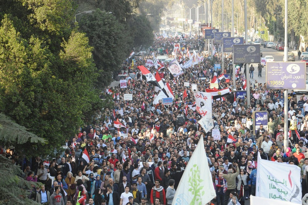 Tens of thousands marching from Mostafa Mahmoud mosque to Tahrir Square, on Friday - the second anniversary of Egyptian revolution - in objection to the political decisions of Egypt(***)s post-revolution president Mohamed Morsi. The majority demanded the downfall of Morsi.