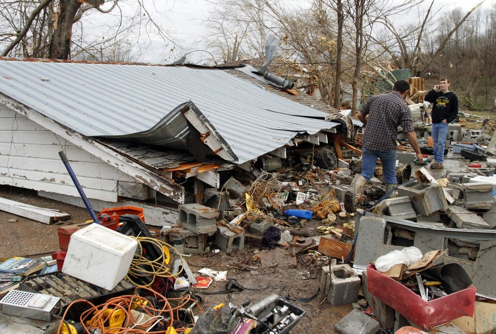 Assessing the damage in Coble, Tennessee after a large storm system packing high winds, hail and several tornadoes tore across a wide swath of the South and Midwest US on Wednesday.