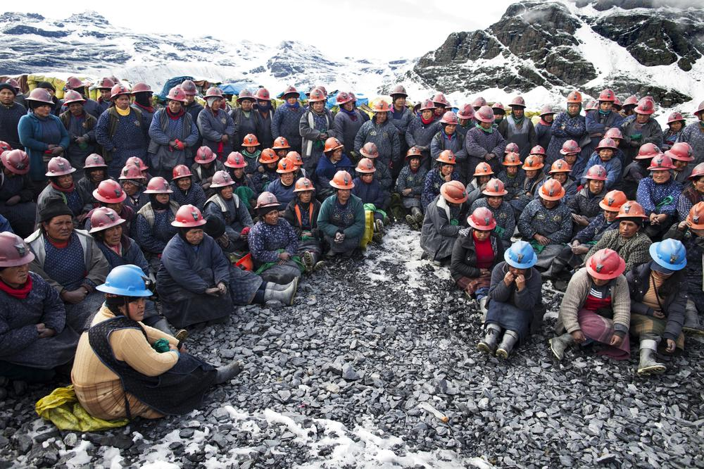 <p>Pallaqueras - women who select stones from the mine dumps - attend an afternoon briefing with their colleagues and the engineers of Corporacion Minera Ananea in La Rinconada, Peru.</p>