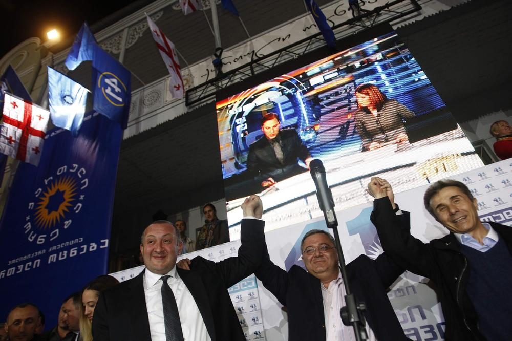 <p>Georgia(***)s Prime Minister Bidzina Ivanishvili (R), presidential candidate Georgy Margvelashvili (L) and Parliament Speaker David Usupashvili celebrate Margvelashvili(***)s victory in Sunday(***)s presidential election.</p>