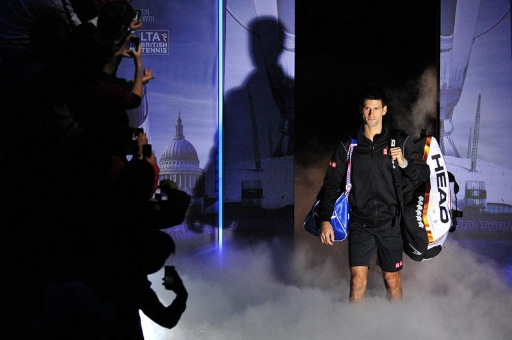 <p>Defending champion Novak Djokovic of Serbia set up a mouthwatering finale to the ATP World Tour Finals against Rafael Nadal after defeating Swiss debutant Stanislas Wawrinka 6-3, 6-3 on Sunday.</p>