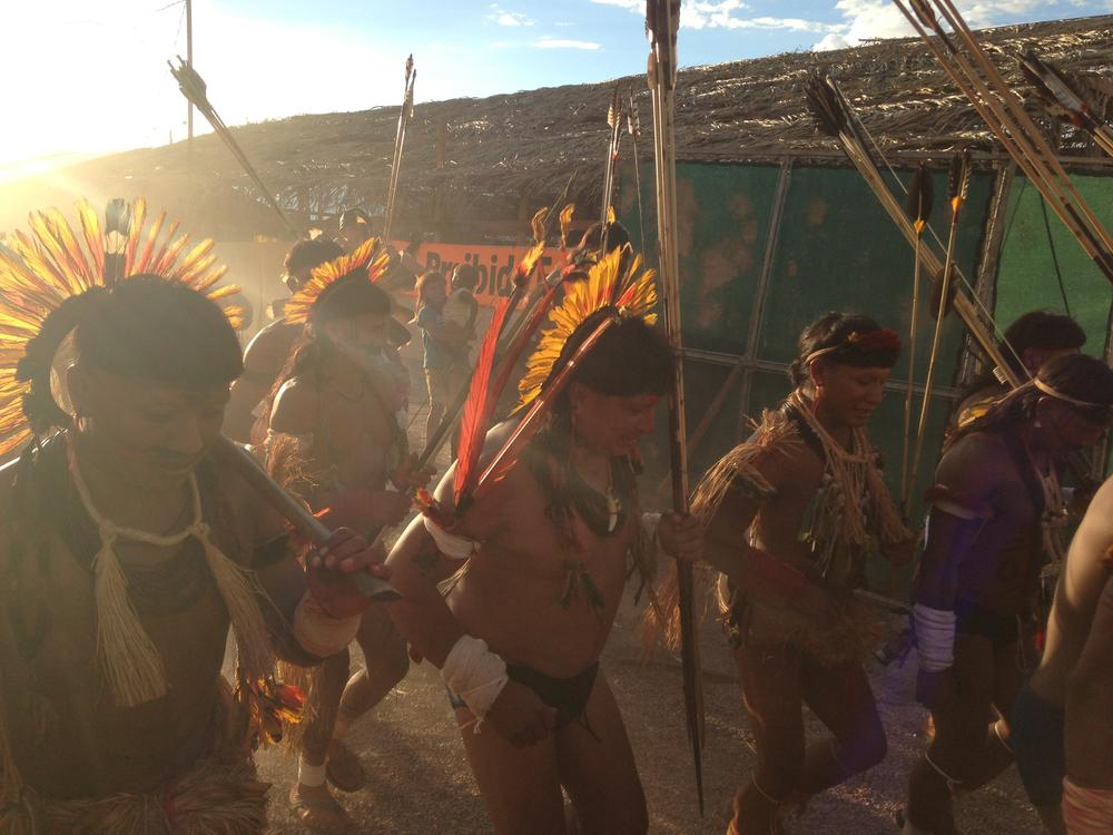 <p>Indigenous people dance in unison in preparation for the games.</p>