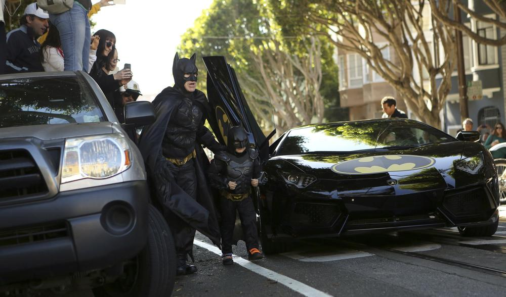 San Francisco, a charity and city residents came together to let a five year old leukemia sufferer play crime fighting \(***)Batkid\(***) and fulfil a wish to be a superhero for a day.
