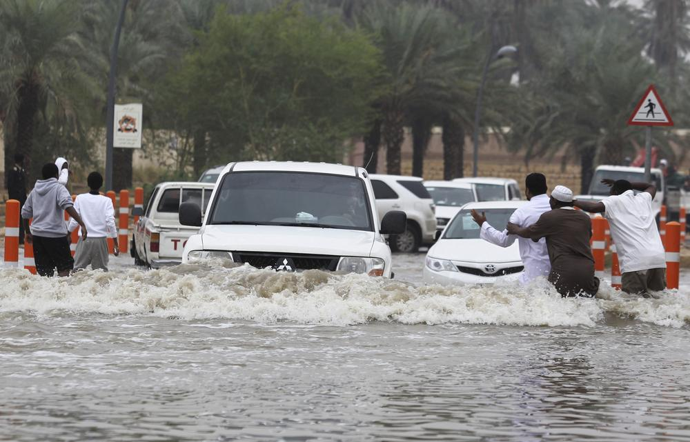 <p>A car drives through a flooded street after heavy rains in Riyadh, Saudi Arabia on November 19.</p>