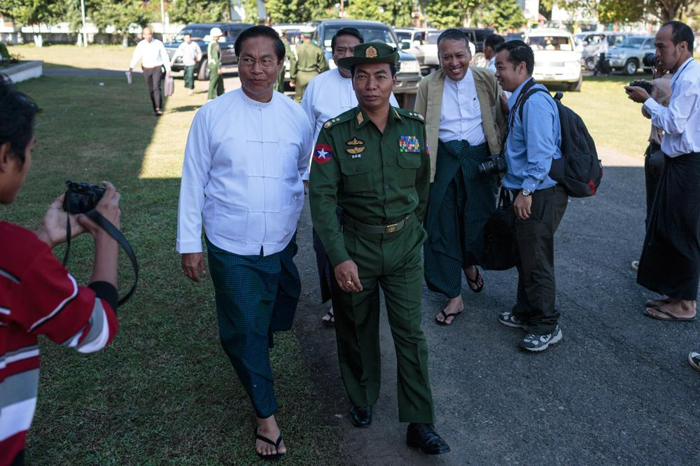 <p>Lieutenant General Myint Soe of the Myanmar army is ushered into the first day of meetings between the military and rebel groups over the possible implementation of a ceasefire agreement in Myitkyina, Myanmar on November 4.</p>