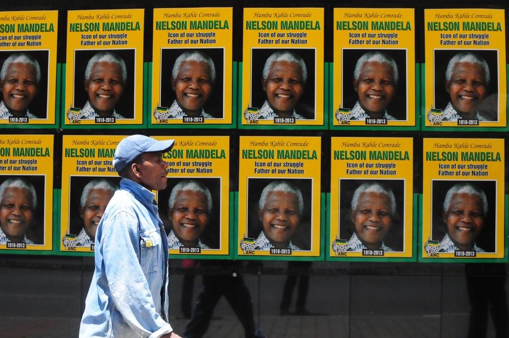 Posters of the former South African President Nelson Mandela outside Luthuli house the ANC headquarters.