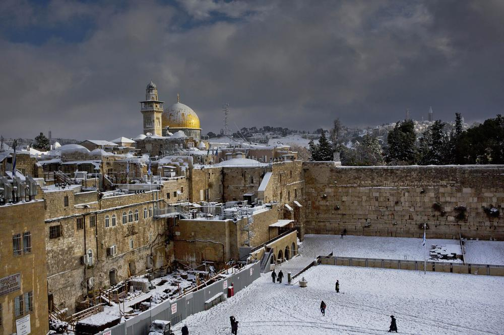 Early snow surprised many Israelis and Palestinians as a blustery storm, dubbed Alexa, brought heavy snowfall.