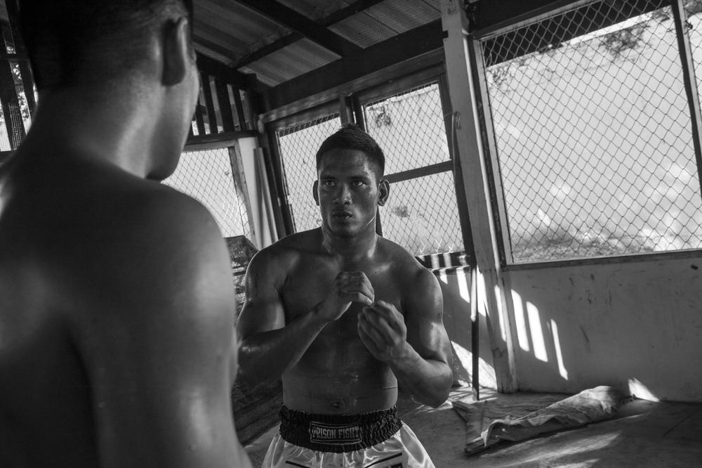 Prisoners spar in the makeshift gym of Khlong Phai prison. The history of Thai prisoners fighting for freedom dates back to the 18th century.