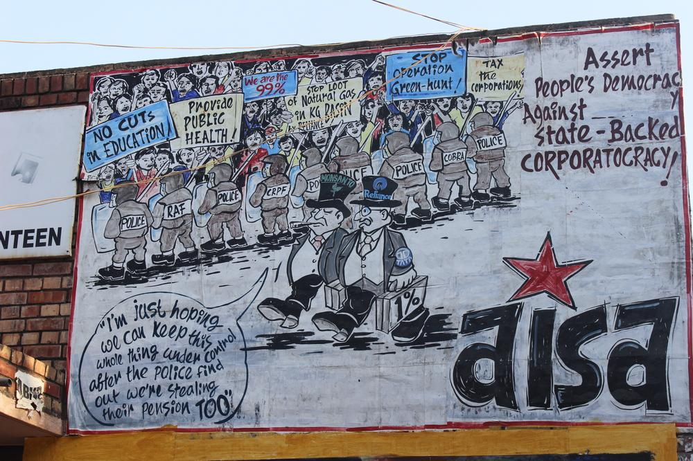 Democracy is subservient to corporate interests is the message in this graffiti put up by All India Students Association, AISA, which is the most popular student group in the JNU campus.