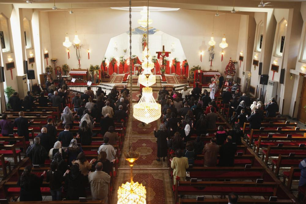 <p>Iraqi Christians attend mass on Christmas at St. Joseph Chaldean Church in Baghdad, December 25, 2013.</p>