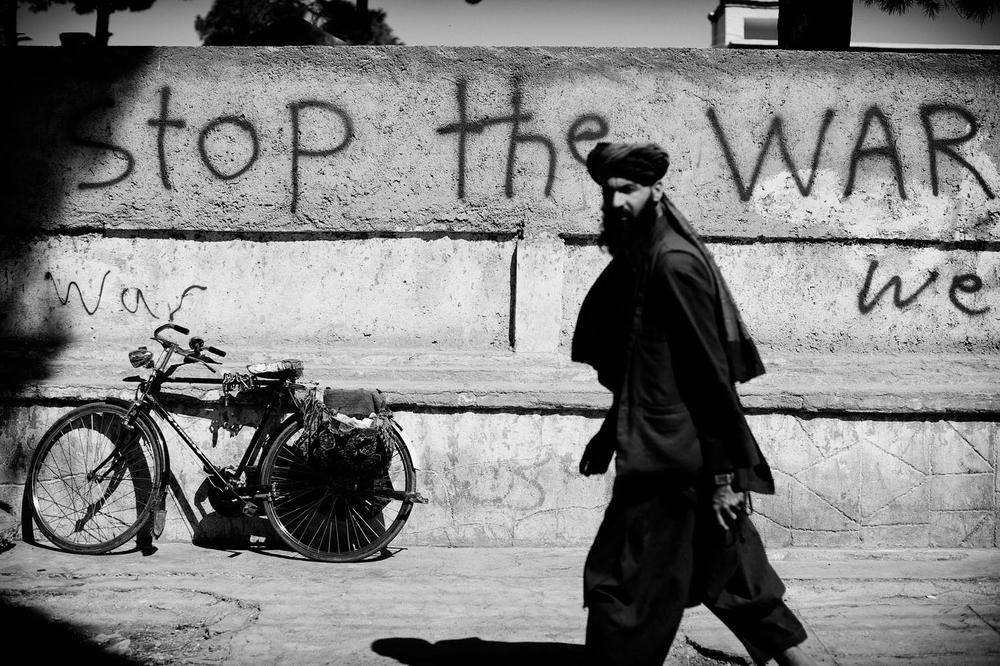 Peaceful slogans are seen on the walls of Herat, September 20, 2013. [John D McHugh/Al Jazeera]