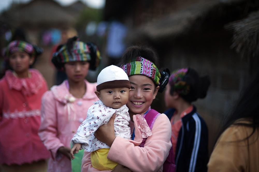 Teenagers wear traditional clothes during Shan New Year in Koung Jor Shan Refugee Camp, Thailand.