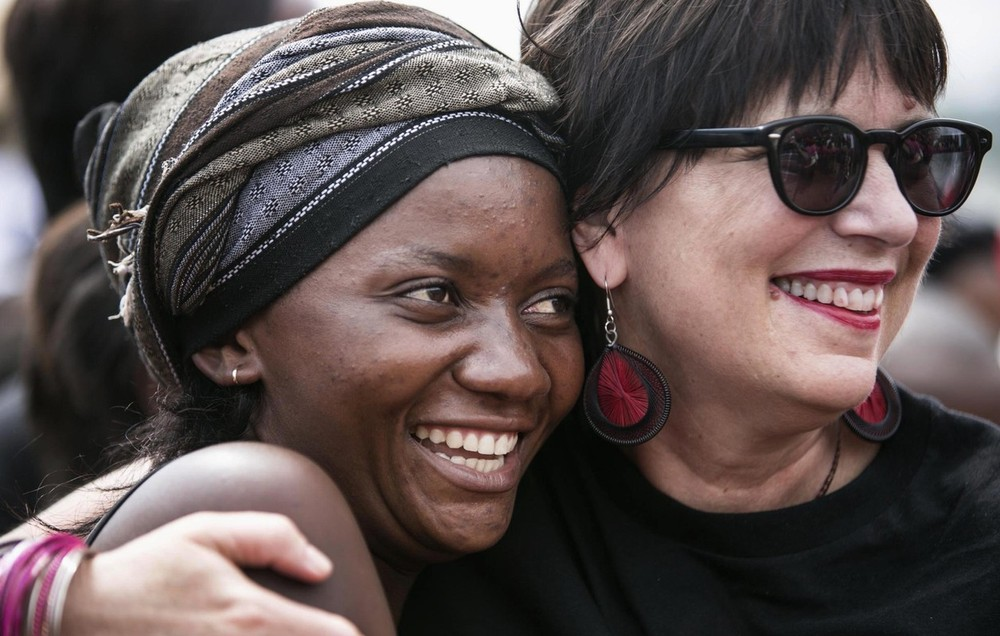 "Eve Ensler (R) founder of V-Day embraces a woman in the crowd during a global rally ""One Billion Rising"", which is part of a V-Day event calling for an end to gender-based violence, in Bukavu, Democratic Republic of Congo on February 14, 2013. V-Day is a global activist movement to end violence against women and girls, said organisers."