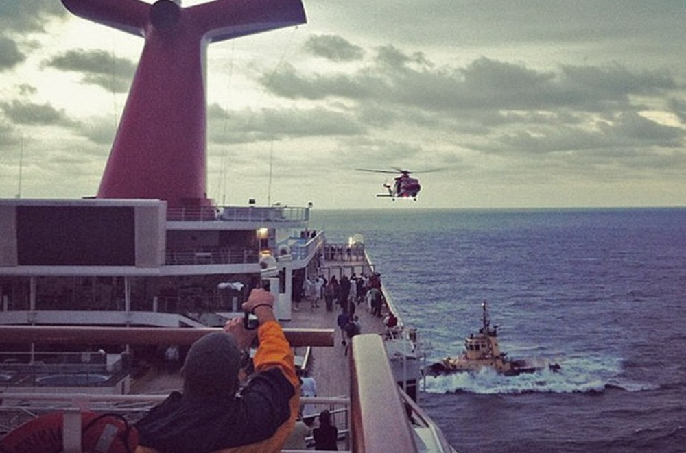 An Instagram photo provided by a passenger of the Carnival Cruise Ship Triumph identifying himself as Mikemoonpie shows a coast guard helicopter flying as the ship is towed toward Mobile, Alabama
